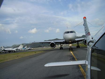 Piper Cherokee single engine 4-seater aircraft taxing in St. Maarten
