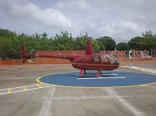 Robinson R44 aircraft parked on Leeward Islands Helicopters' St. Maarten Heli Pad